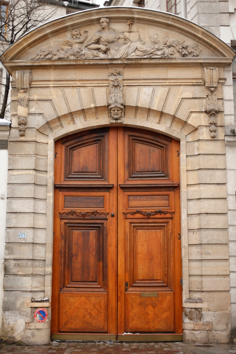 This was once the entrance to the home a a really importance person of the 17th century-- Issac Laffemas.  Chief of Police under Cardinal Richelieu and later executioner for Louis XIV.  The reclining woman with her scales of justice and olive branch are the clue...